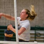 Bonita High School Volleyball player spikes a ball over the net